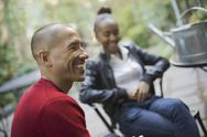 Stock Photo of scenes from urban life in new york city. a man and a teenage girl sitting out