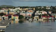 Stock Video Footage of St Johns Antigua city harbor colorful buildings 2 HD 1327