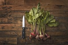 a handful of small beets, fresh organic vegetables harvested for the table. a - stock photo