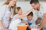Stock Photo of Parents and children baking cookies