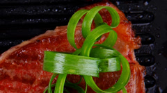 Bloody beef fillet steaks with green leaves Stock Footage