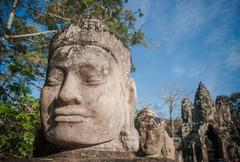 Head of gate guardian, angkor, cambodia Stock Photos