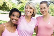 Stock Photo of Multiethnic volunteers participating in breast cancer awareness
