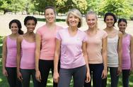 Stock Photo of Volunteers supporting breast cancer awareness in park