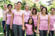 Stock Photo of Multiethnic females supporting breast cancer awareness
