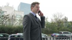 Successful Businessman Talking On Phone In Busy Urban District. Stock Footage