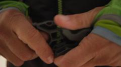 Female Hands closing a rucksack belt Stock Footage