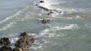 Stock Video Footage of small waves flowing over rocks 2