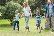 Stock Photo of Parents and kids walking in park