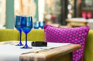 Stock Photo of Blue Glasses On Restaurant Table