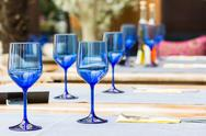 Stock Photo of Empty Blue Glasses On Restaurant Table