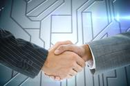 Stock Illustration of Composite image of business handshake against circuit board