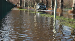 4 Wheel drive passes flooded foot path Stock Footage