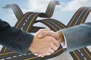 Stock Illustration of Composite image of business handshake against road