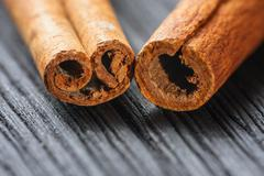 Cinnamon on the wooden background Stock Photos