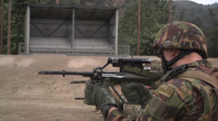 US - Army - Shooting Training 22 - Steyr reloading kneeled Stock Footage
