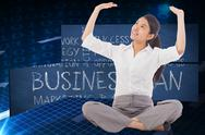 Stock Illustration of Composite image of businesswoman sitting cross legged pushing up