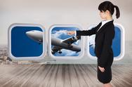 Stock Illustration of Composite image of focused businesswoman pointing