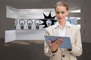 Stock Illustration of Composite image of thoughtful stylish businesswoman looking at tablet