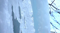 Frozen waterfall detail water runs down an icicle-slow motion. Stock Footage