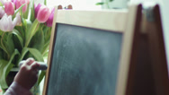 Stock Video Footage of small girl practicing simple math on chalk board