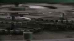 Gears spinning with pan 2 Stock Footage