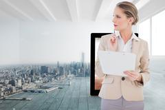 Composite image of pensive blonde businesswoman holding clipboard Stock Illustration