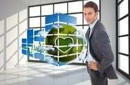 Stock Illustration of Composite image of cheerful businessman standing with hands on hips