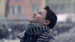 Young teenage boy enjoying snow, super slow motion, shot at 240fps HD Stock Footage