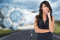 Composite image of pensive elegant dark haired model posing with finger on her Stock Illustration