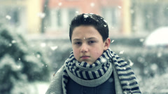 Young sad boy in snowy weather, super slow motion, shot at 240fps HD Stock Footage