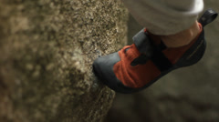 Climbing shoe on granite Stock Footage