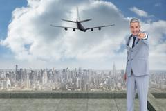 Composite image of confident businessman posing and pointing at camera Stock Illustration