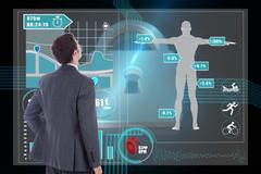 Stock Illustration of Composite image of businessman standing with hand on hip