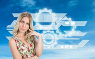 Stock Illustration of Composite image of frowning pretty blonde wearing flowered dress posing