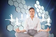 Stock Illustration of Composite image of businesswoman sitting in lotus pose