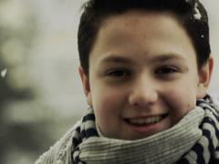 Portrait of happy cute young boy in snowy weather NTSC Stock Footage