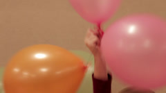 Joyful kids dancing with balloons - stock footage
