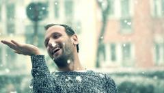 Man enjoying falling snow, super slow motion, shot at 240fps HD Stock Footage