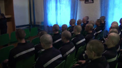 Prisoners and convicted persons watching TV Stock Footage