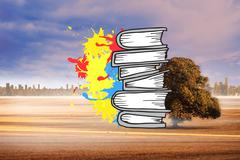 Composite image of pile of books on paint splashes Stock Illustration