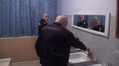 Prisoners and convicted persons wash and brush their teeth Stock Footage