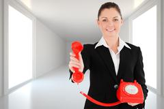 Composite image of charming woman in suit holding a red telephone Stock Illustration
