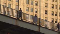 CHI WrigleyBldg pedestrians tilt Stock Footage