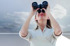 Composite image of businesswoman looking through binoculars - stock illustration