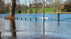 Cyclist, jogger & car in English floods Stock Footage
