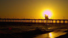 Golden Sunset on Huntington Beach, CA Stock Footage