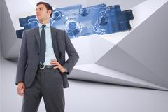 Stock Illustration of Composite image of stern businessman with hand on hip