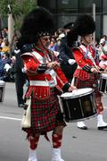 Kilted drummer in marching band Stock Photos
