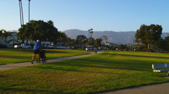Stock Video Footage of Jogging in Late Afternoon in Santa Barbara, CA.  Camera Zooms In.